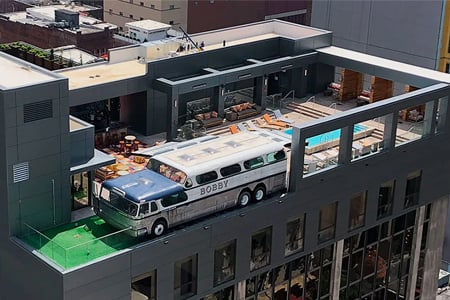 the-bobby-hotel-in-nashville-has-a-custom-greyhound-bus-on-the-roof